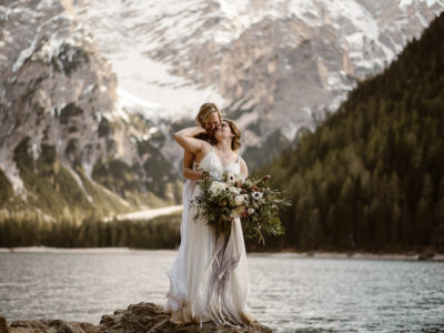 Two brides embrace during their elopement in the Dolomites