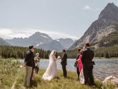 An intimate wedding ceremony by a lake in Coloraod