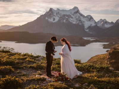A lesbian couple exchanging vows by a lake in Patagonia