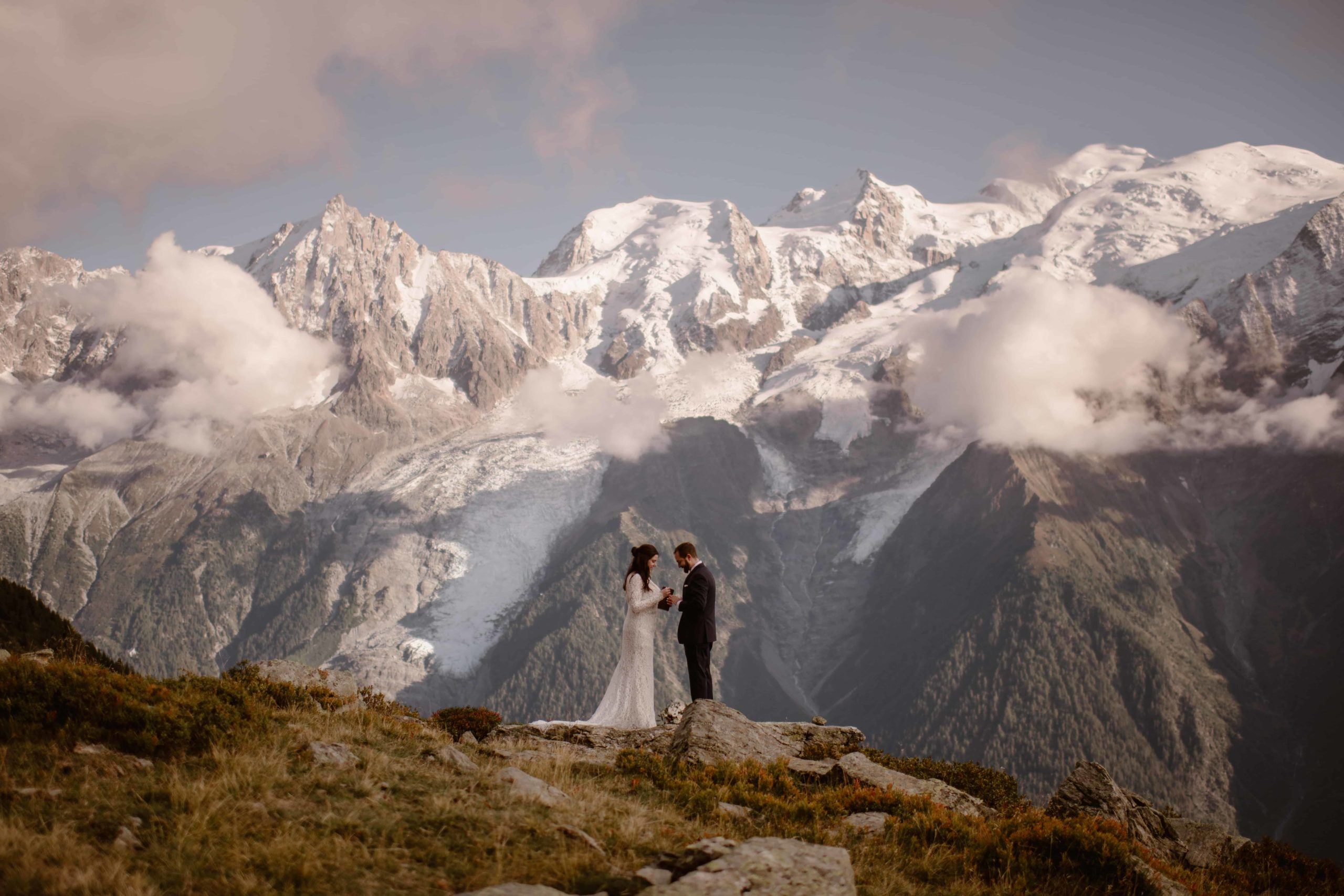 A couple elopes in the mountains near Chamonix, France.