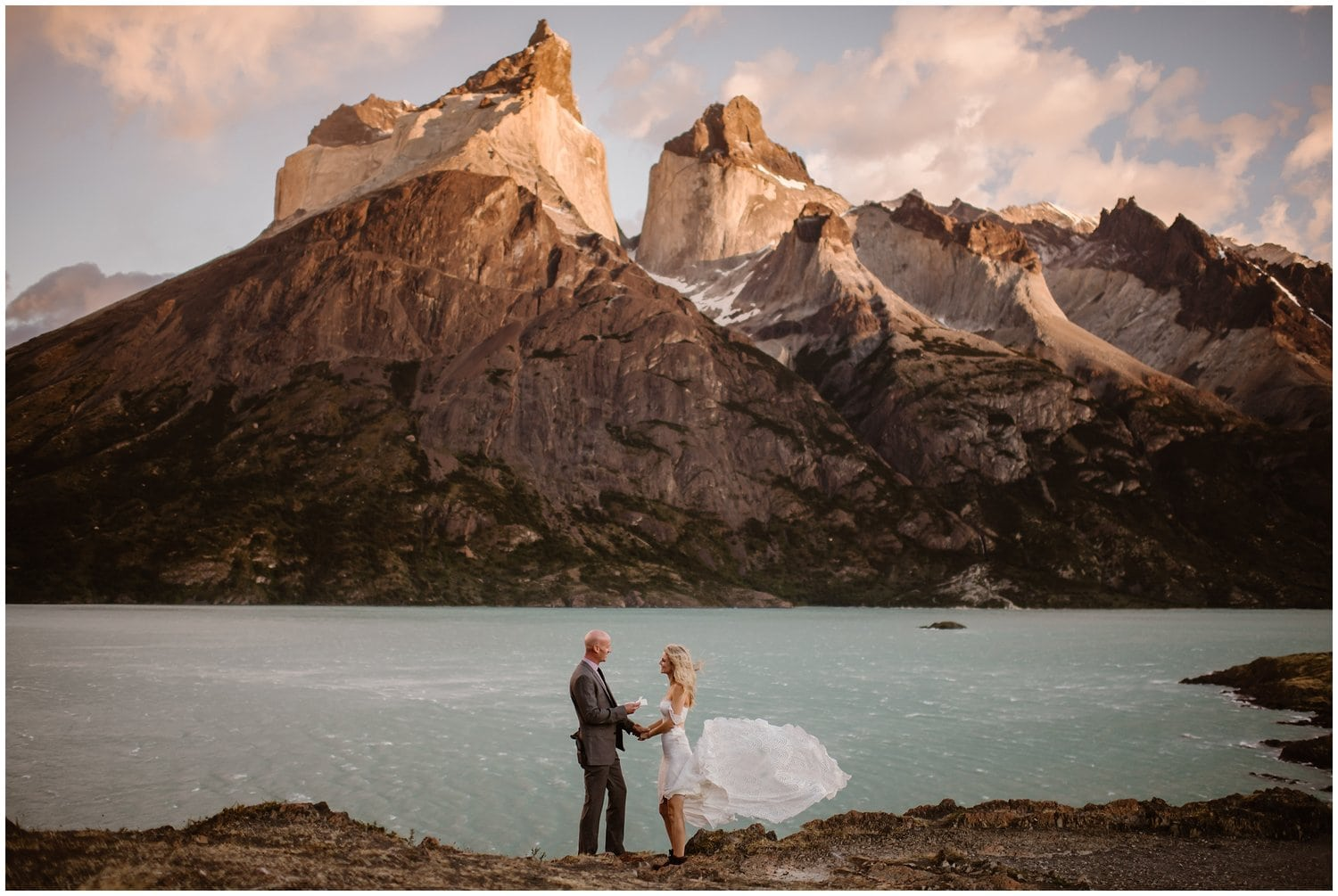 Bride and groom say their vows during their wedding ceremony in the mountains.