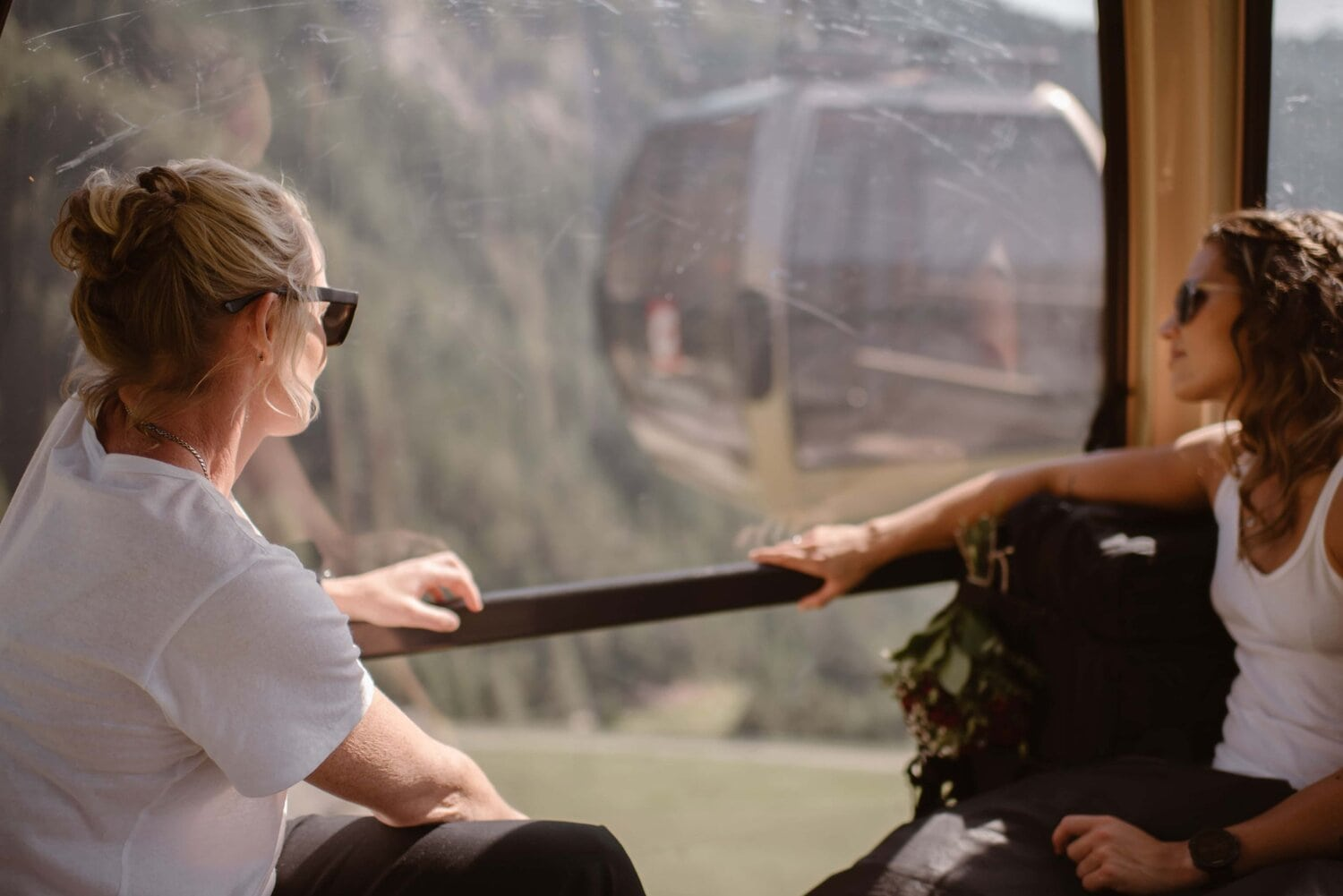 Two women riding in a shuttle over the Italian Dolomites.