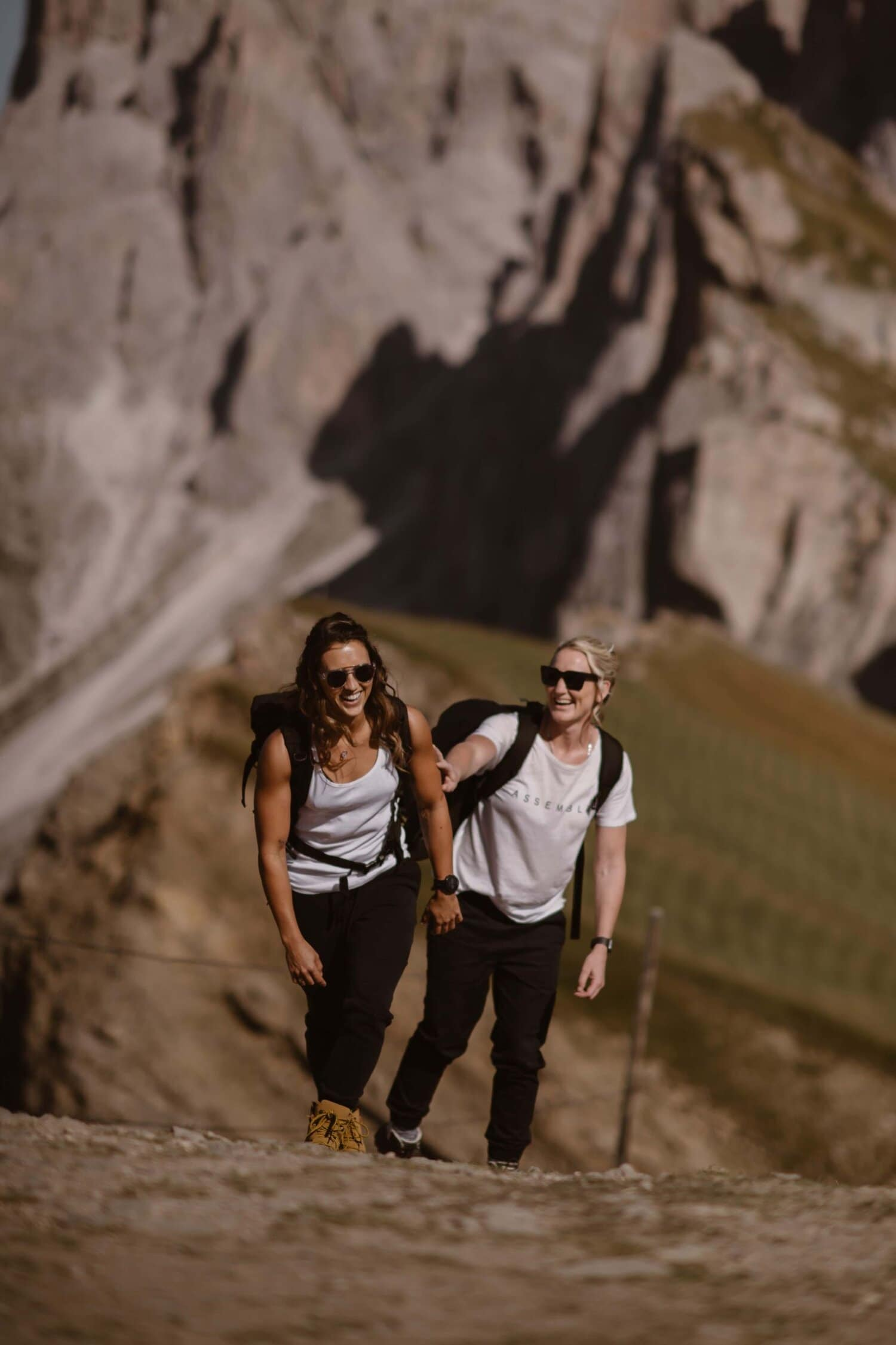 Two women hike the Italian Dolomites.