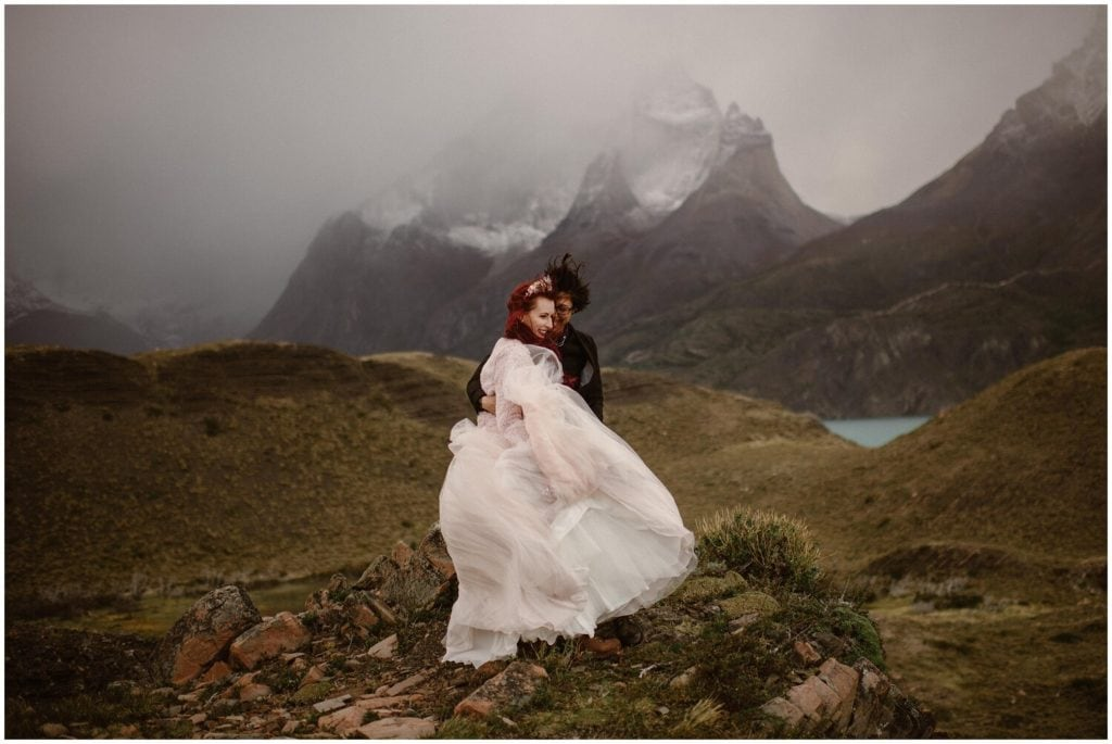 A couple embraces on their wedding day in Patagonia.