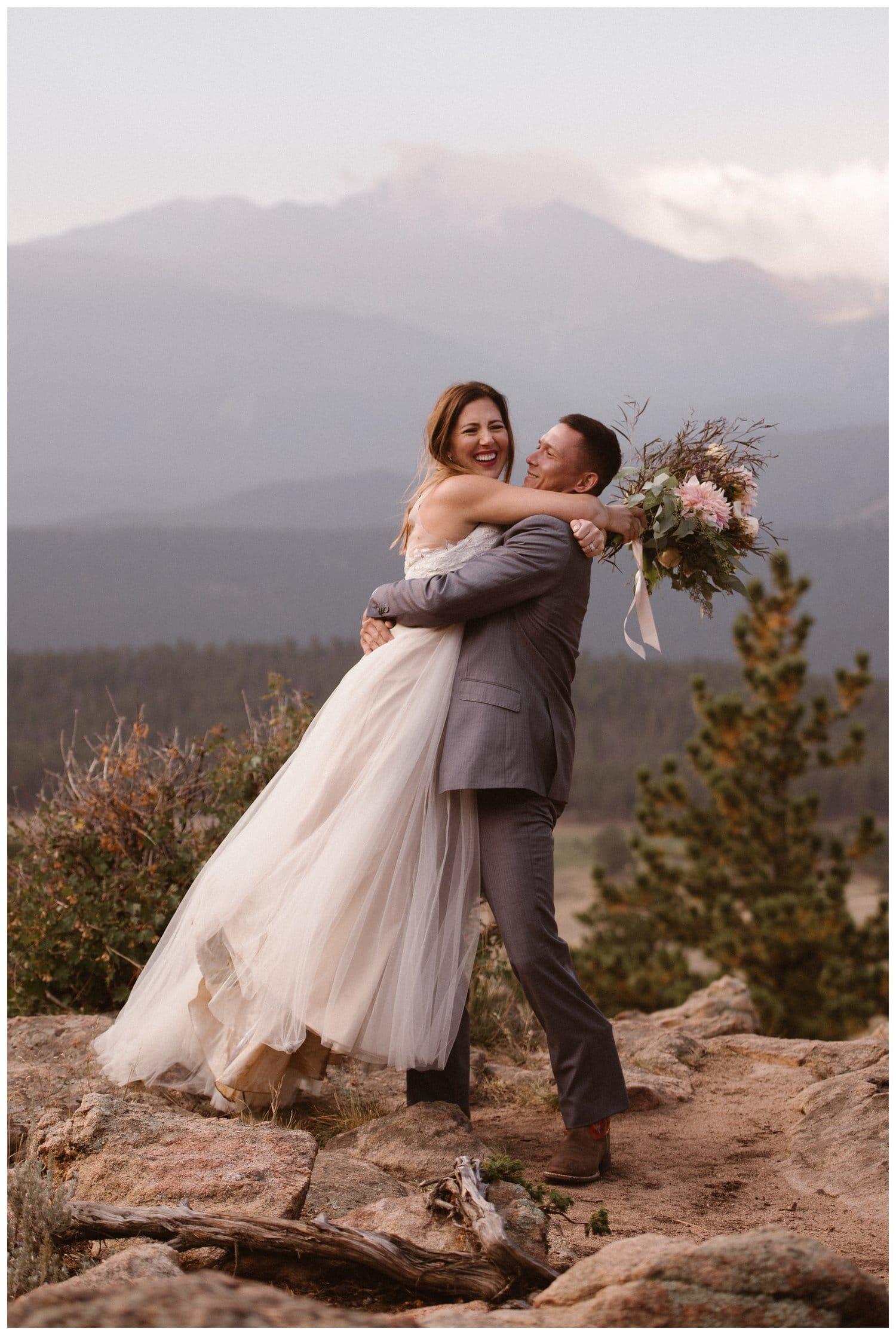 Groom lifts up bride at Yosemite National Park.