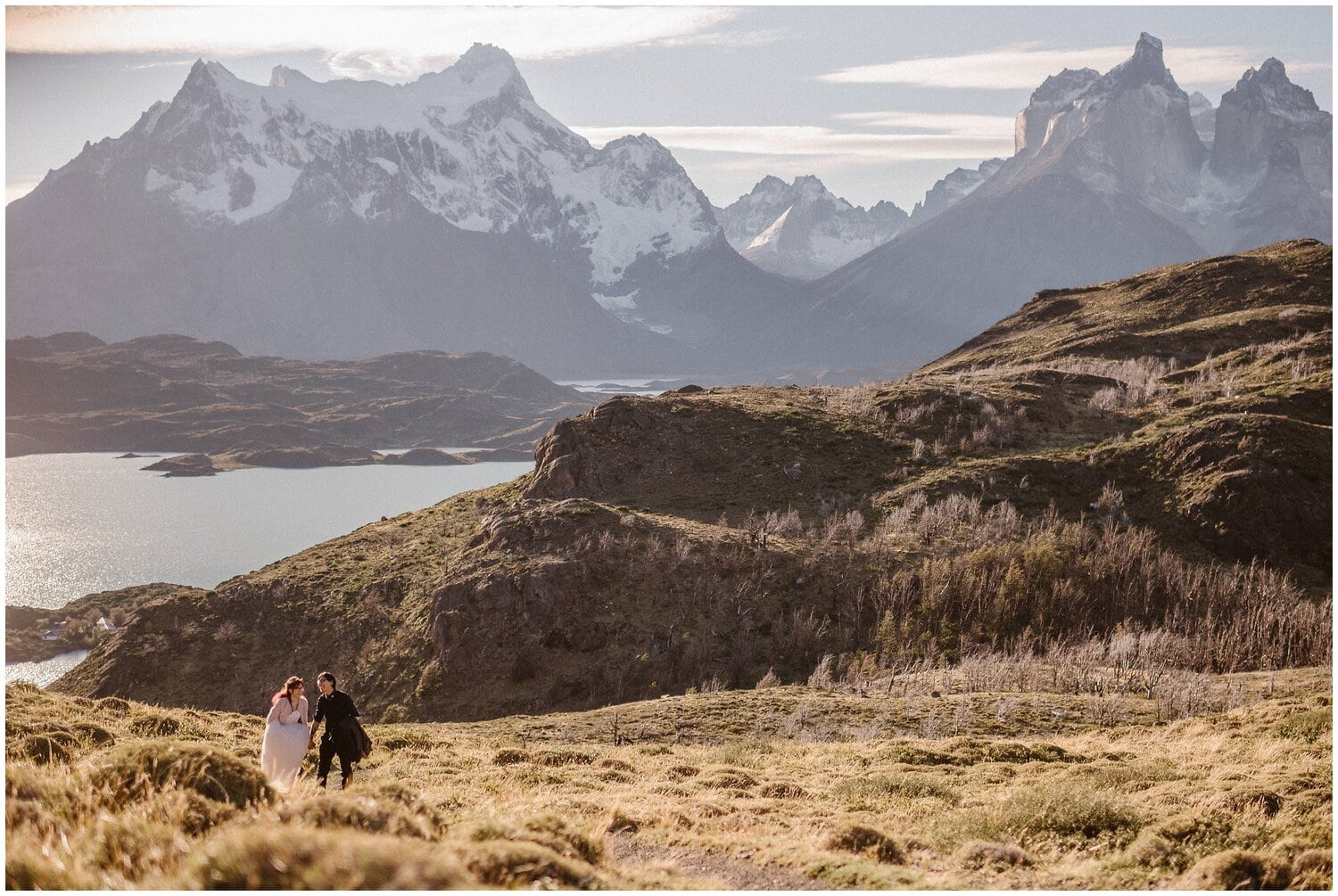 A couple holds hands on their wedding day in Patagonia.