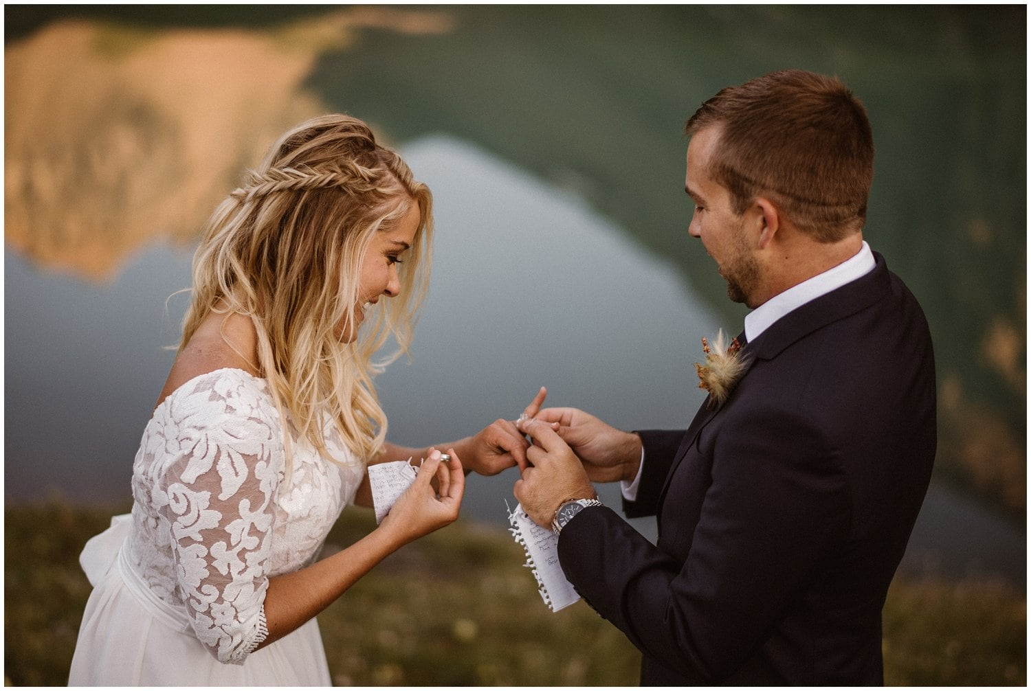 Groom puts ring on bride during their elopement ceremony.