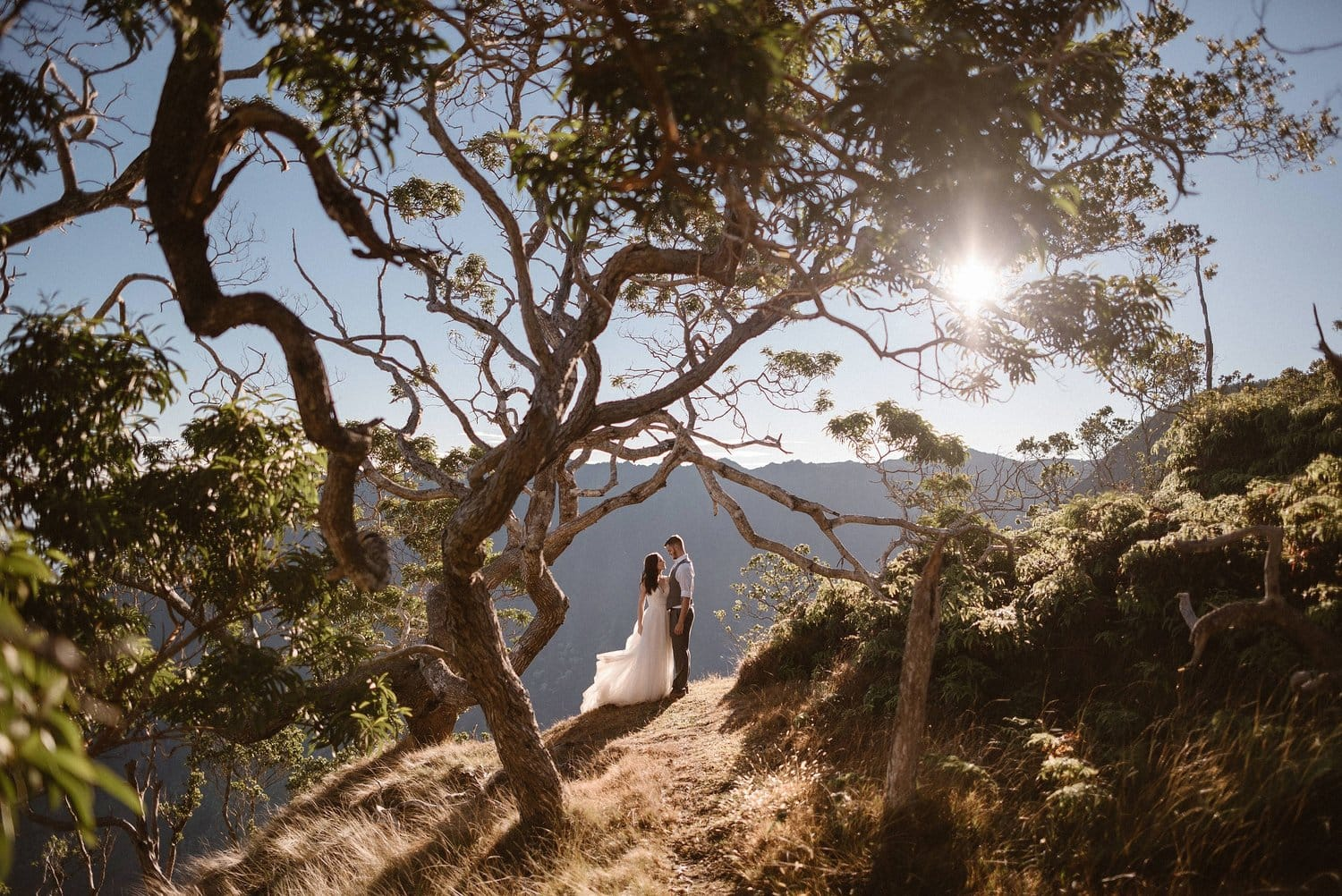 Bride and groom embrace on their wedding day in Hawaii.