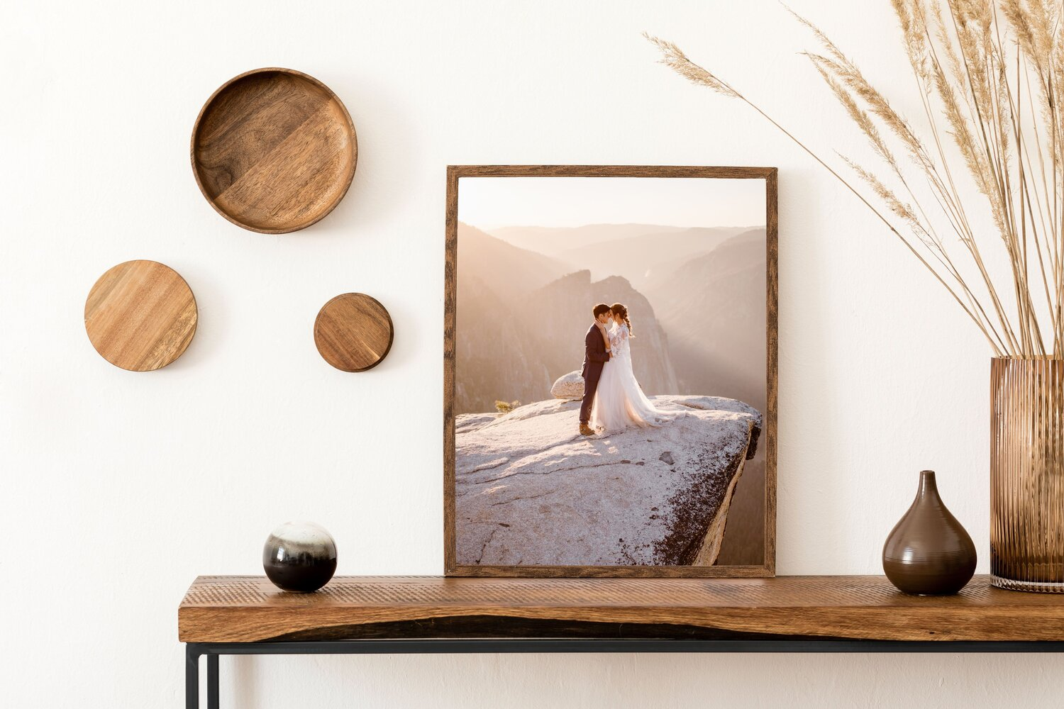 A wedding photo in a picture frame sitting on a table.