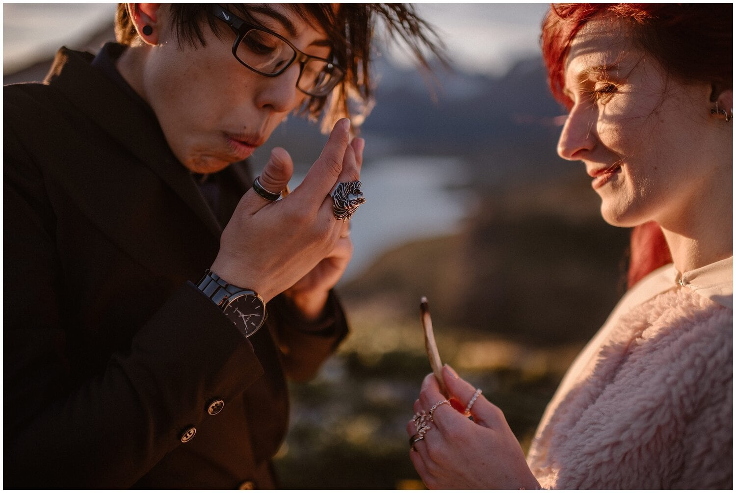 Couple holds a match stick during their wedding ceremony in Patagonia.