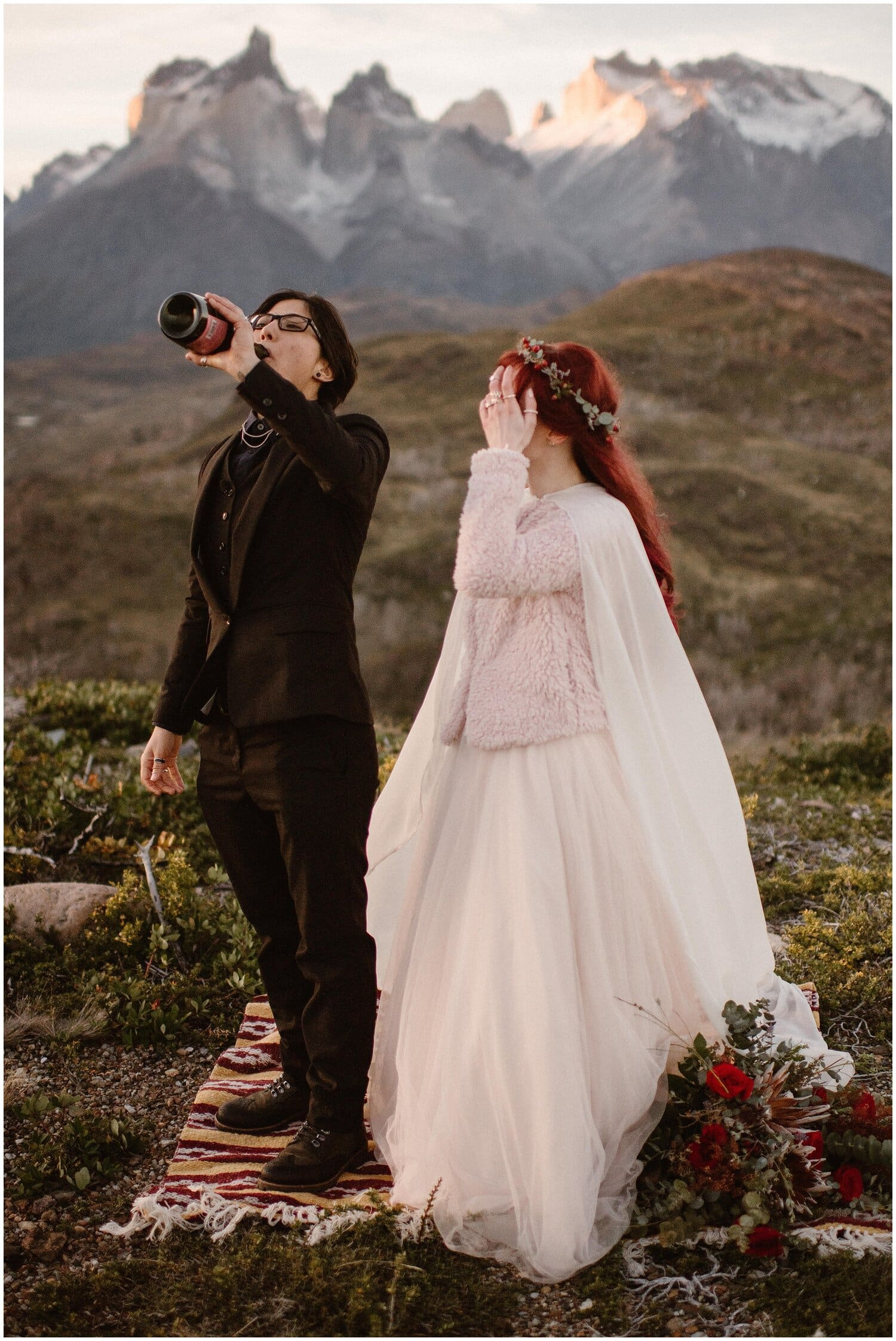 Couple sprays a bottle of champagne on their wedding day in Patagonia.