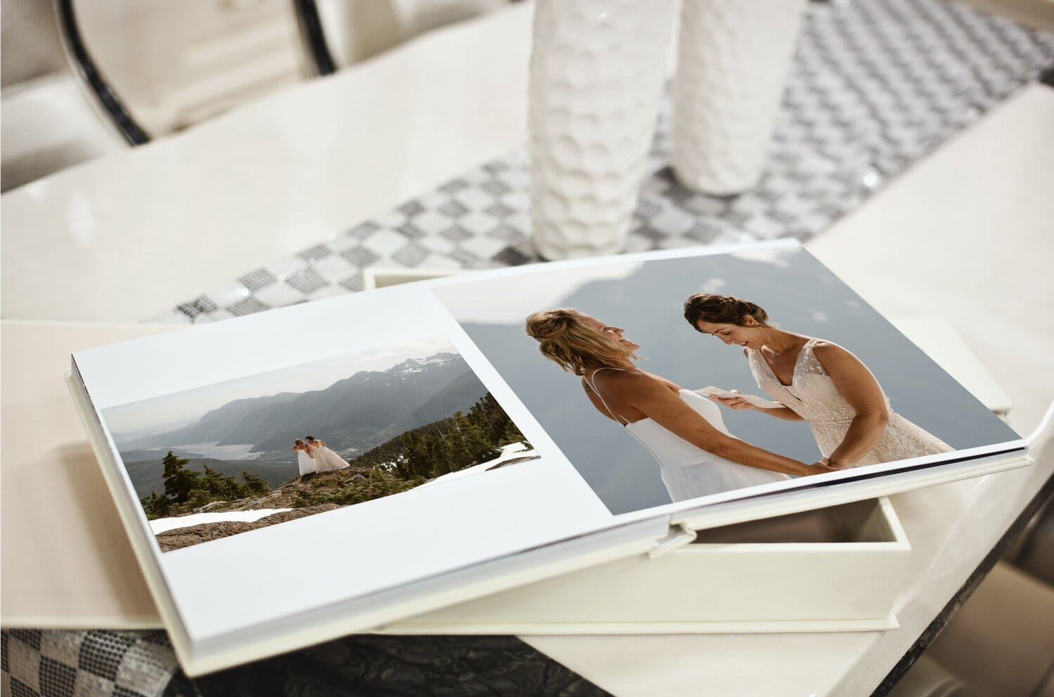 A wedding photo album sits on a table.