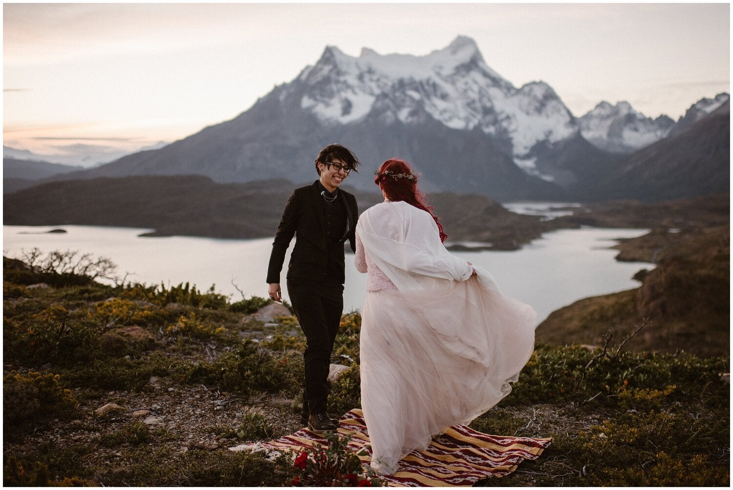 Couple smiles at each other on their wedding day in Patagonia.