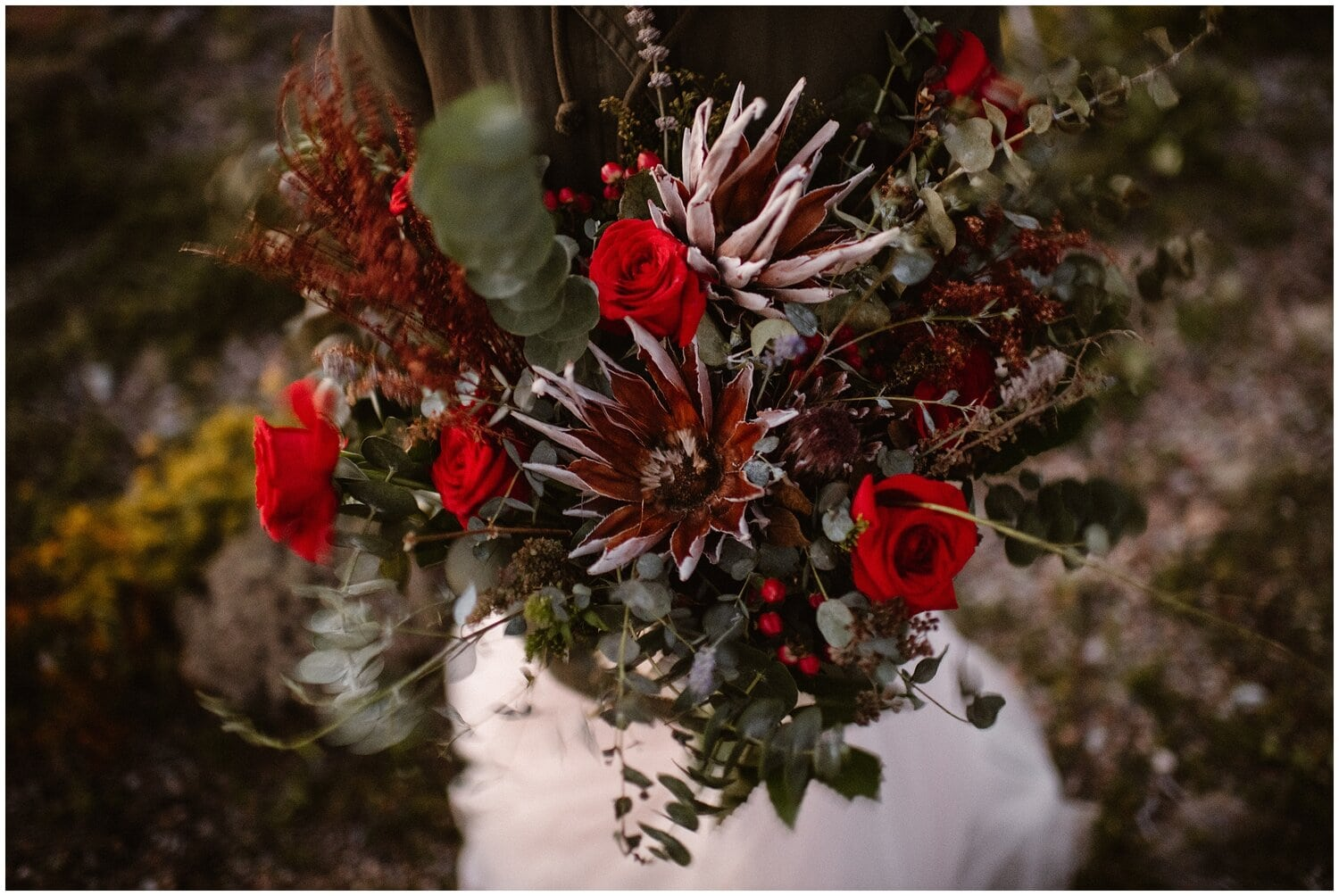 Close-up of red wedding flowers.