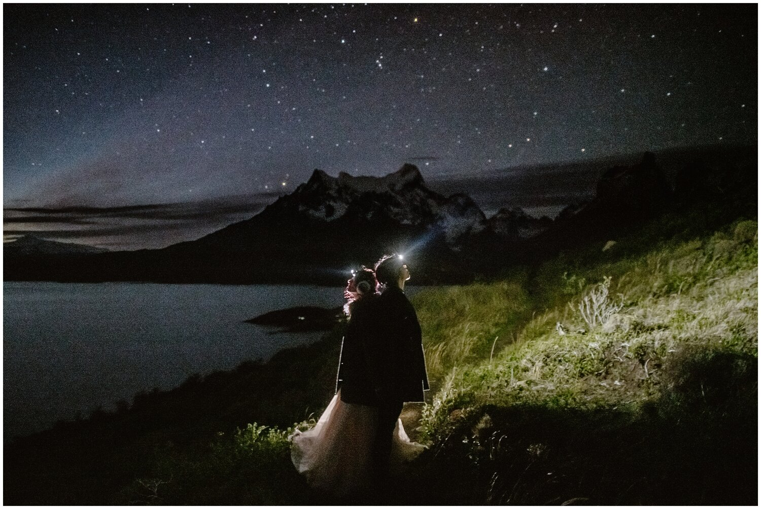 Couple wearing headlamps while looking up at the stars.