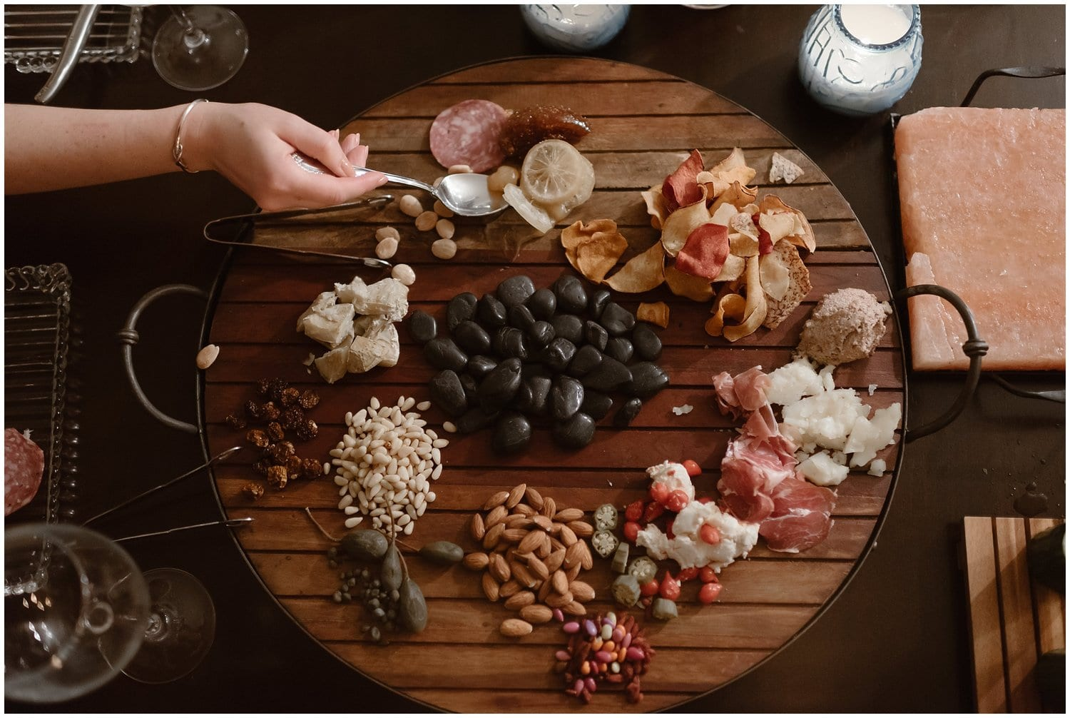Close up of a charcuterie board filled with nuts, cheese, meat, fruit, and more.