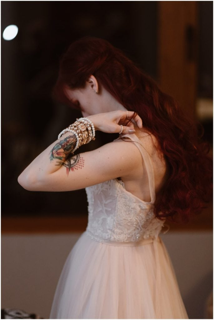 Bride putting on her wedding dress.