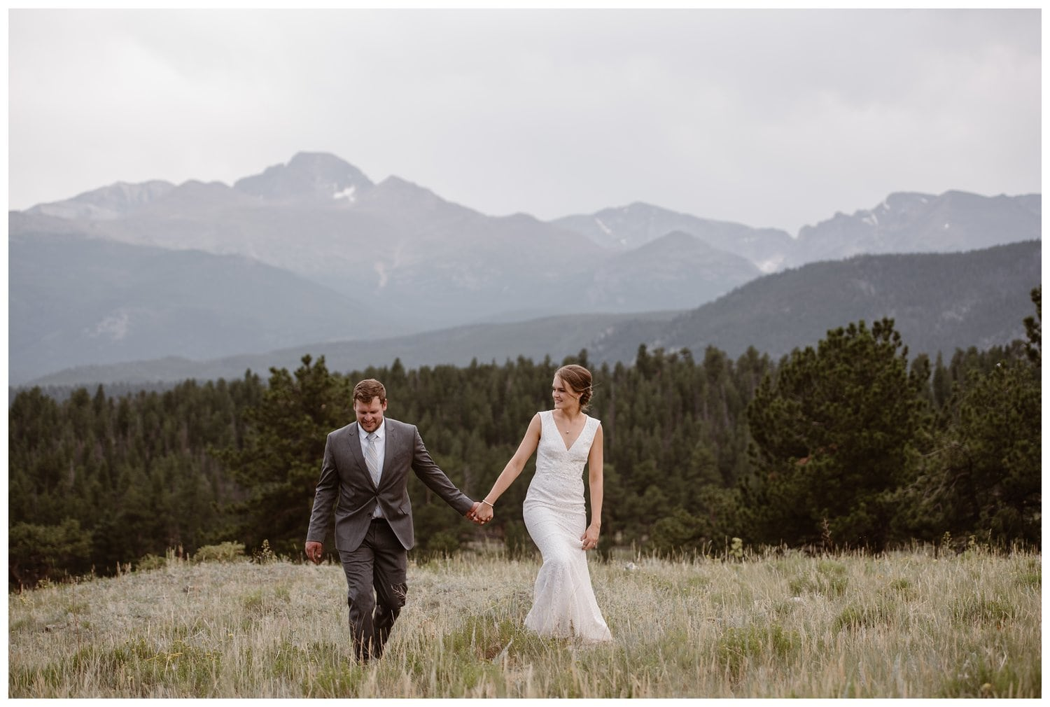 Bride and groom hold hands at Yosemite National Park.