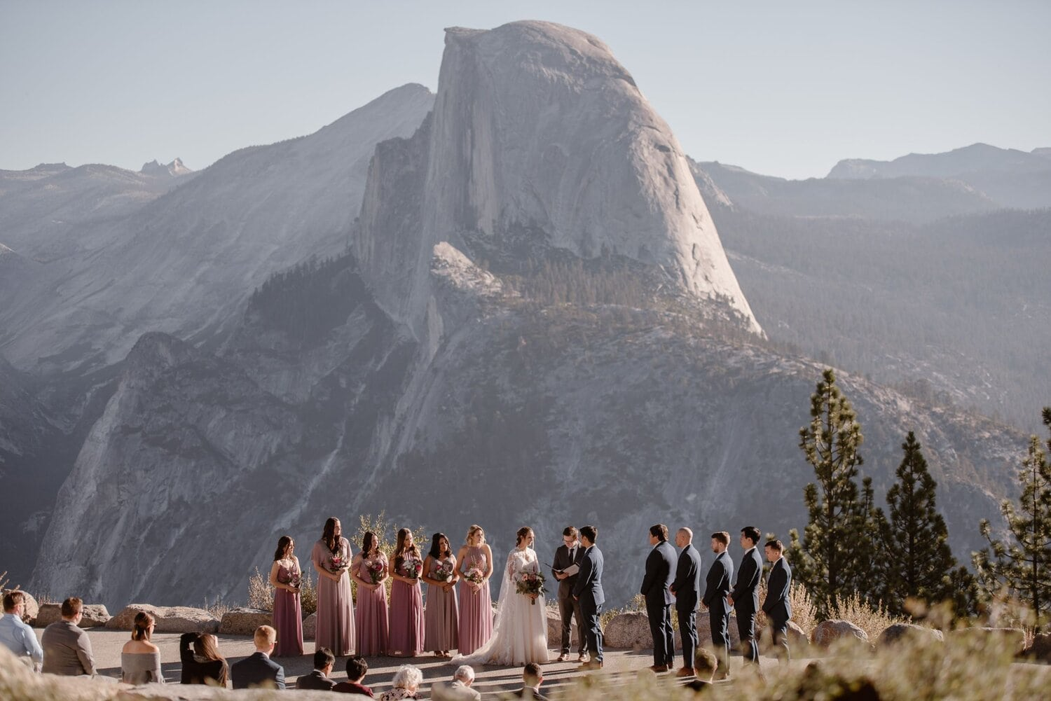 Bride and groom have an intimate wedding ceremony in the mountains with their family and friends.