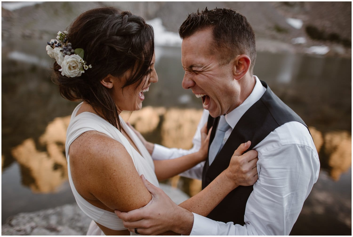 Close-up of bride and groom laughing during their elopement ceremony.