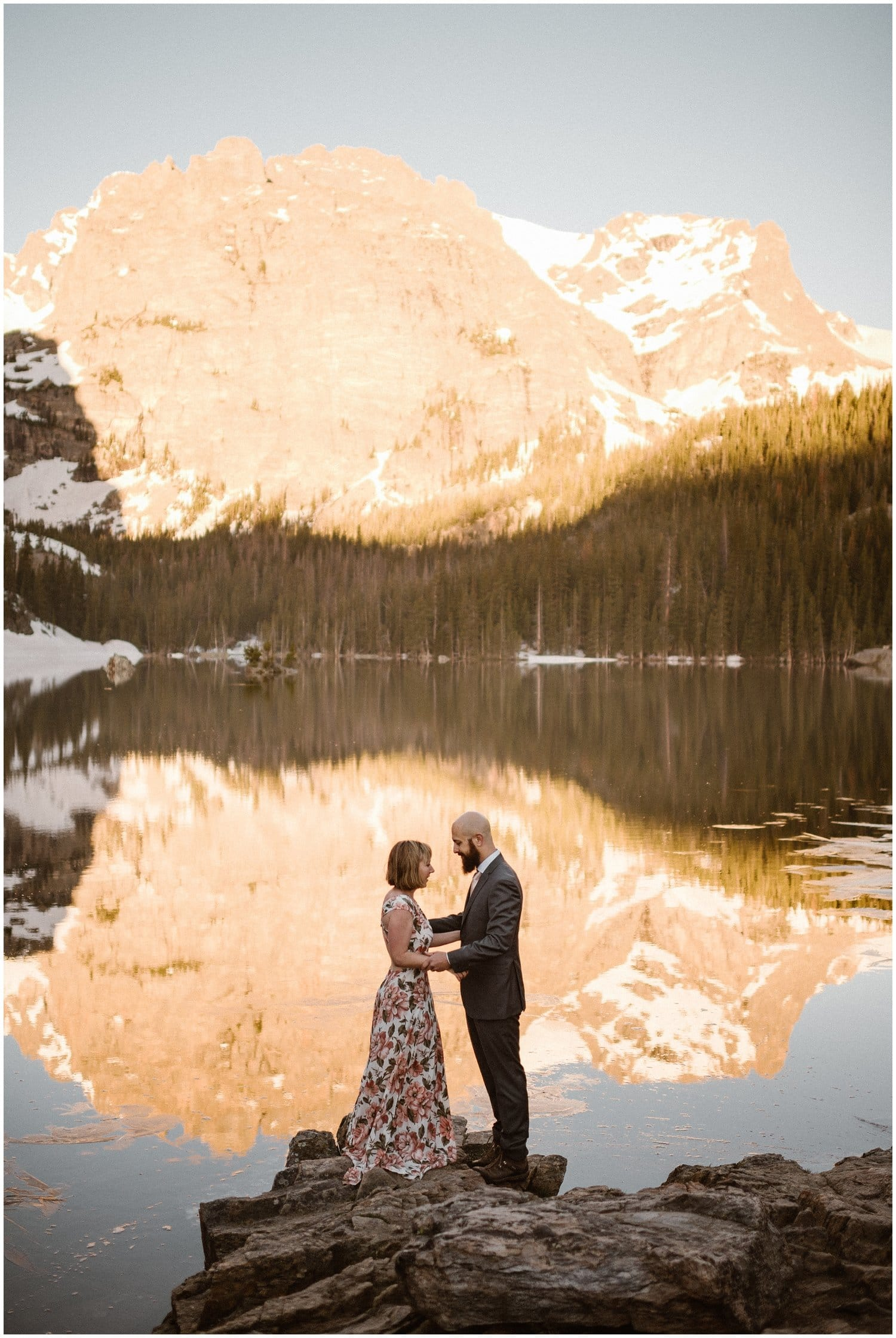 Bride and groom embrace in the Colorado mountains on their wedding day.