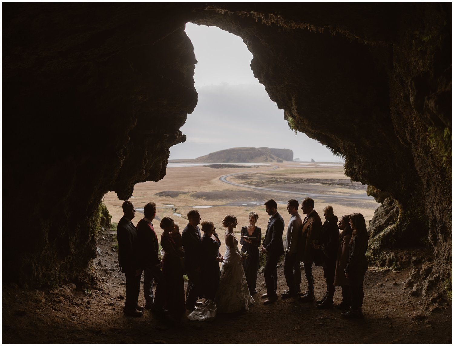 A bride and groom have their wedding ceremony with their loved ones standing by their side.