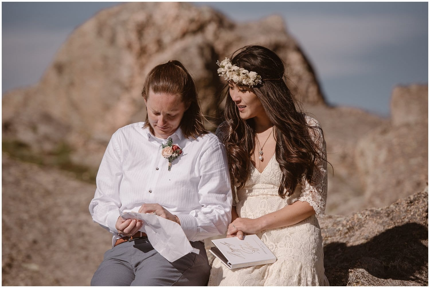 A couple read letters from family and friends on their wedding day.