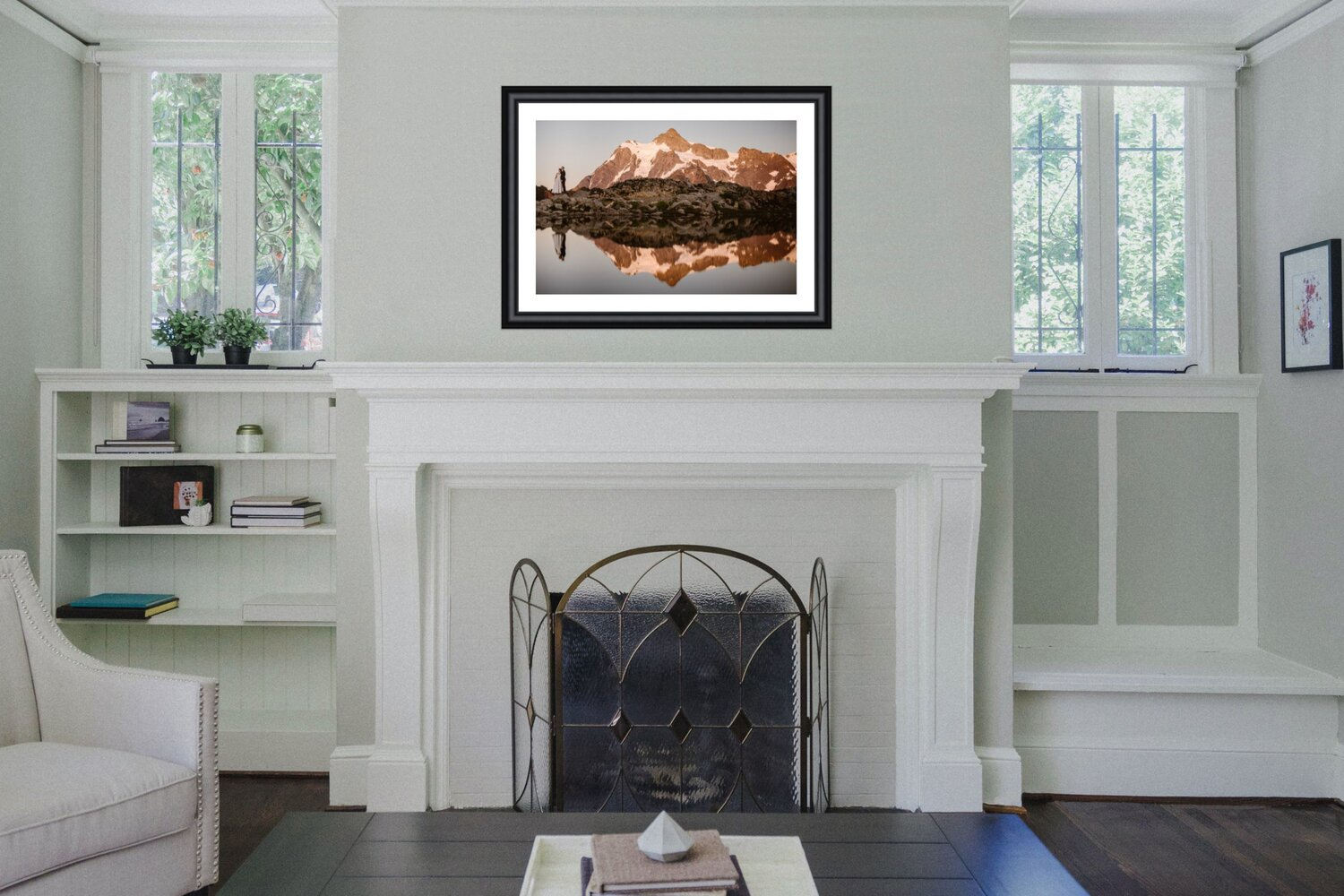 A wedding photo on a mantel display hanging above a fireplace.