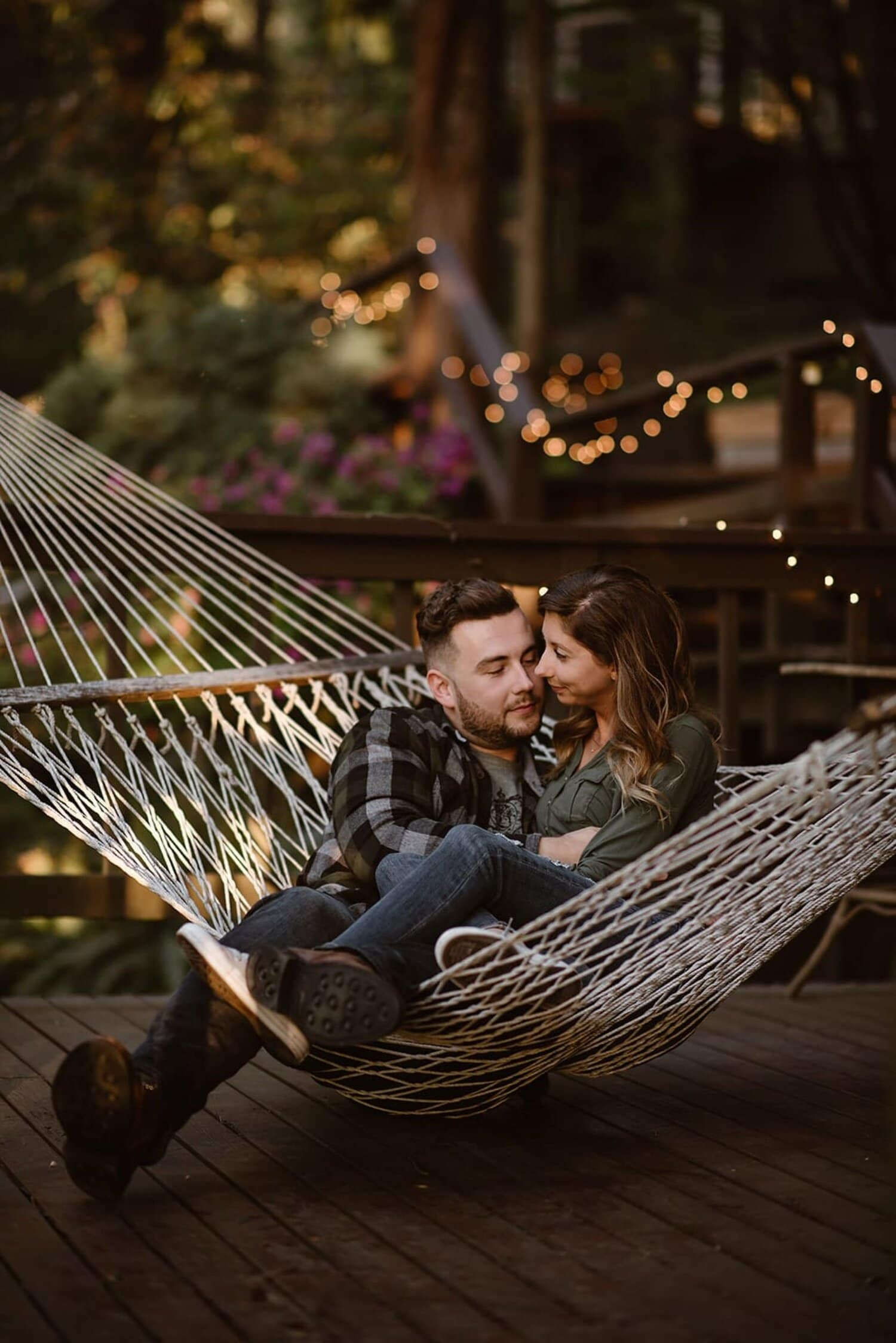A couple sit in a hammock at an Airbnb.