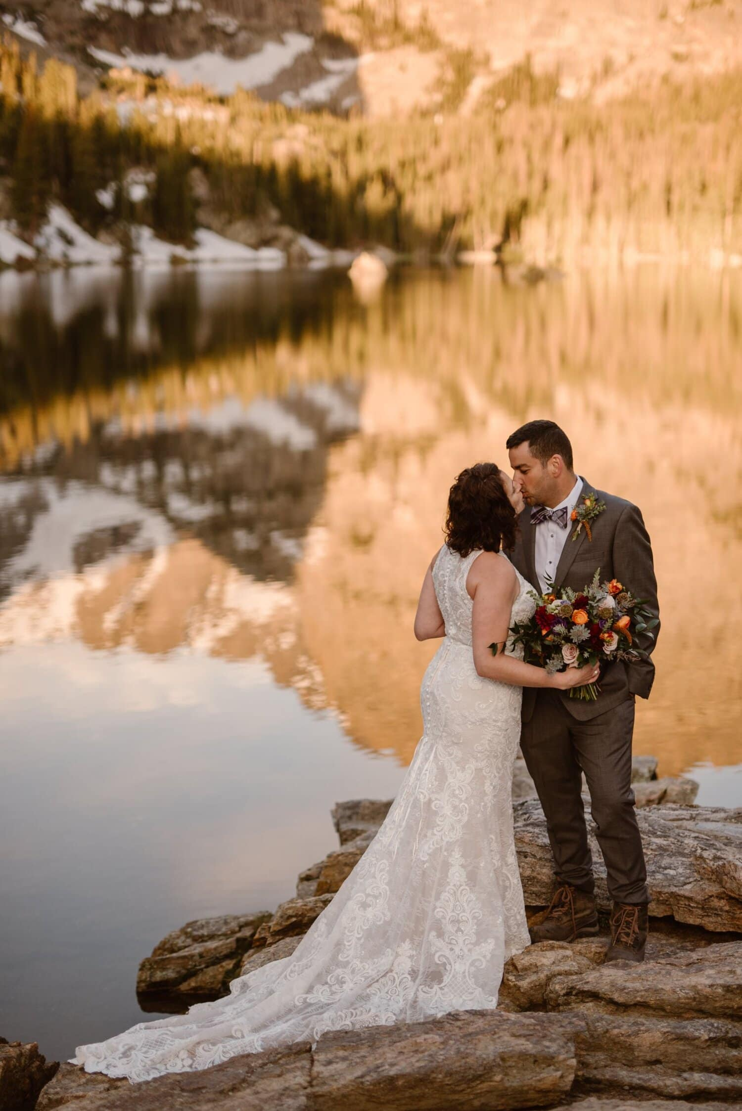 Bride and groom kiss during their elopement ceremony.