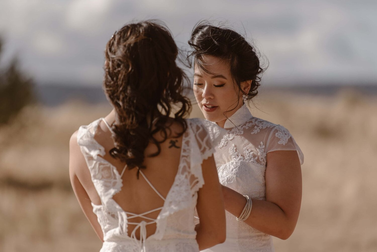 Two brides exchange vows during their wedding ceremony.