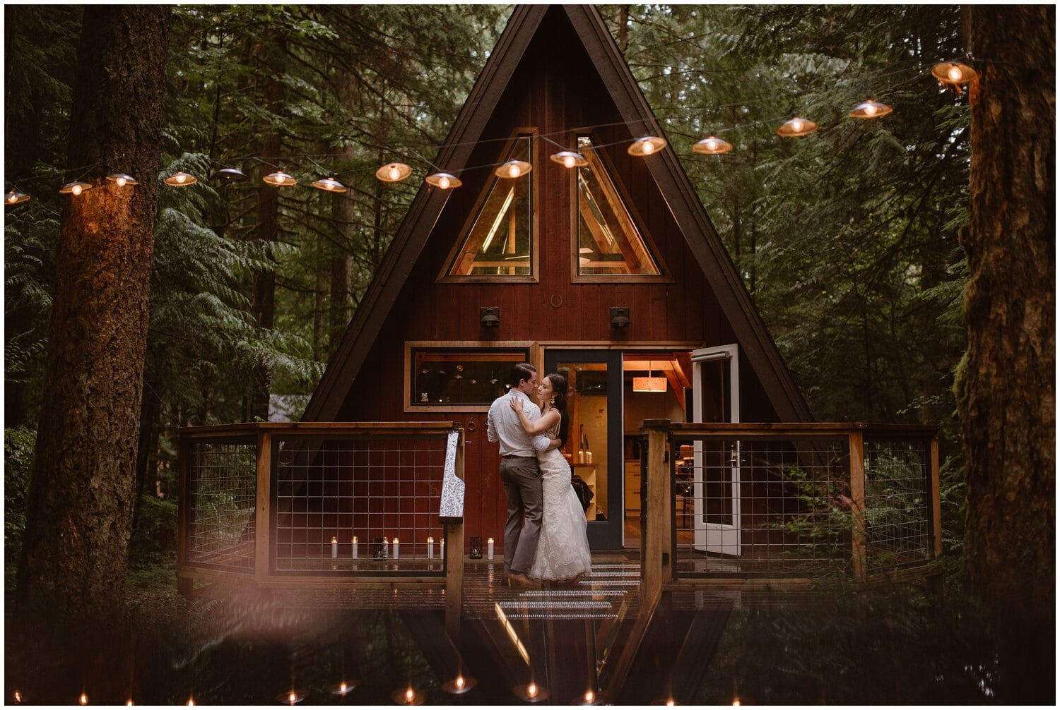 Bride and groom embrace in front of a romantic treehouse.