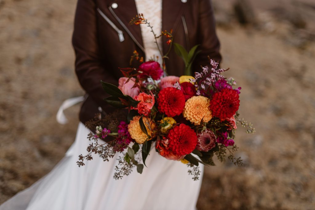 A bride holds a bouquet of flowers.